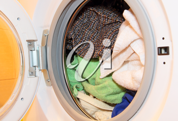 Various clothes in washing machine.