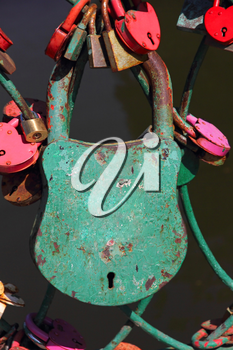 Big grunge green heart lock romance love taken closeup with empty space.