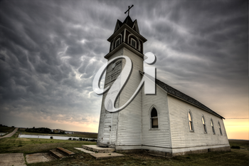 Storm Clouds Saskatchewan with old wooden church in foreground