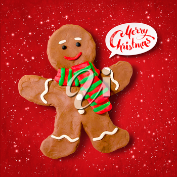 Vector hand made plasticine illustration of gingerbread man cookie with shadow isolated on red festive grunge bacground with snowfall and light sparkles.