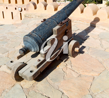 castle and cannon near the wall in oman muscat the old