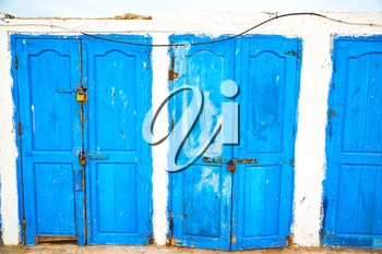 in africa morocco  old harbor wood   door and the blue sky