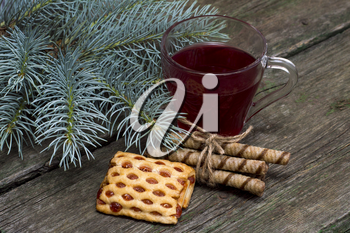 cup of tea a fir-tree branch and cookies