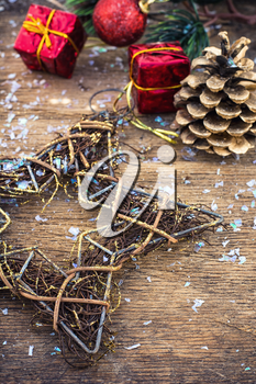 Christmas decoration for decorations on snowy wooden background.Photo tinted.