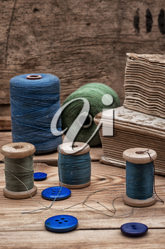 spool sewing thread and buttons in vintage style