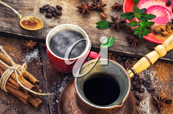 Red with warming Cup of coffee,turk and spices.