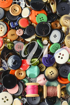 Set of various sewing buttons and thread.Top view
