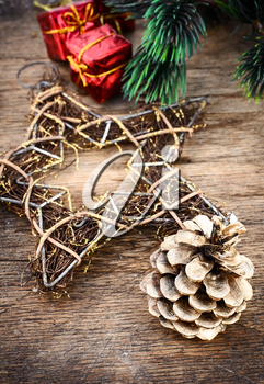 Christmas decorations and gifts on a background of pine branches