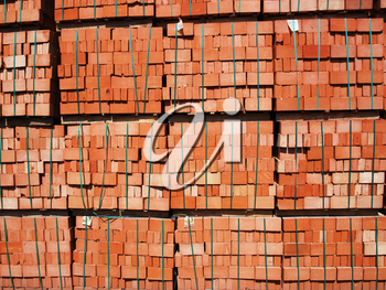 Just made red bricks stacked in several rows for sale