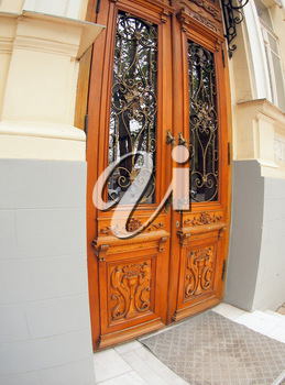 The door to the building of the 19th century after restoration with wide angle distortion view