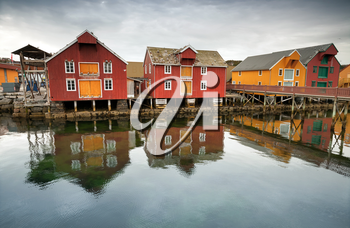 Red and yellow wooden houses in Norwegian fishing village. Rorvik, Norway