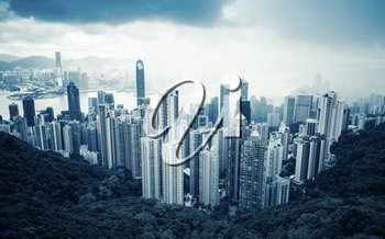 Cityscape Hong Kong, aerial blue toned photo taken from Victoria Peak viewpoint