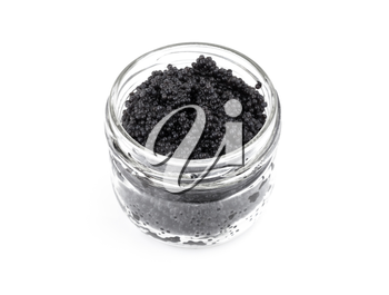Black caviar in a glass jar isolated on white