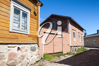 Street view of historical Finnish town Porvoo, colorful facades of wooden houses