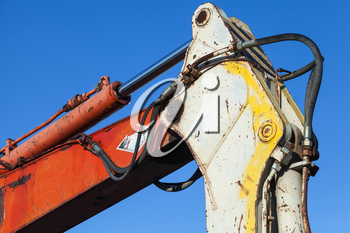 Colorful fragment of industrial excavator and blue sky