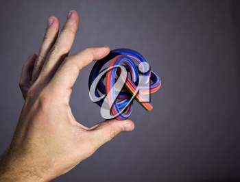 Extraordinary geometric solid object - toroidal knot as example of modern colorful 3d printing possibility
