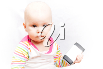 Little baby in casual colorful striped clothing holds mobile phone