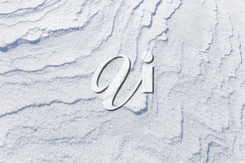 Abstract background texture of snowdrift with nice curved shadows
