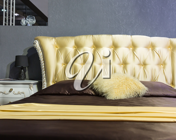 Classical luxury interior of bedroom. Closeup view of bed
