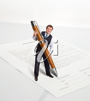 Man with a big pen is going to sign a document