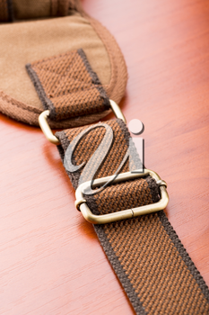 A closeup of metal backpack buckle