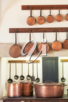 Retro kitchen interior with old pans, pot on the furnace close up