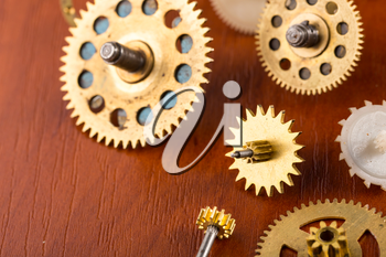 Old different gears on the wooden table