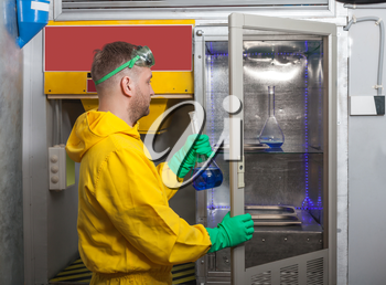 Man in protective suit working in the lab