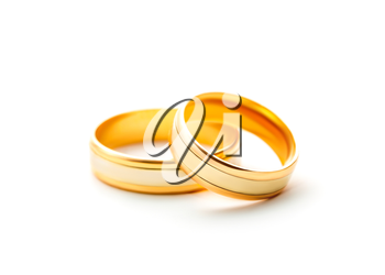 Pair golden wedding rings isolated on white background