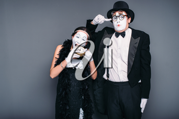 Mime actors performing, actress nibble alarm clock. Pantomime theater performers