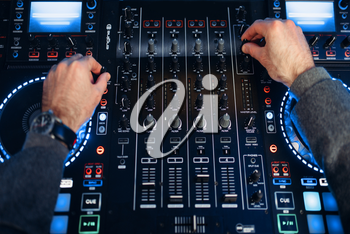 Sound operator hands over the remote control panel in the recording studio. Musician at the mixer, professional audio mixing