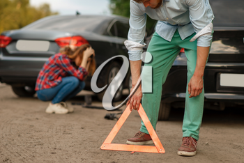 Car accident on road, male and female drivers. Automobile crash, emergency stop sign. Broken automobile or damaged vehicle, auto collision on highway