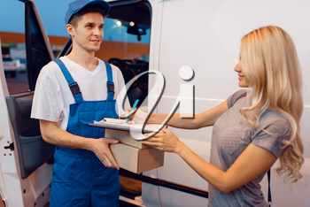 Deliveryman in uniform gives parcel to female customer at the car, delivery service. Man holding cardboard package near the vehicle, male deliver and woman, courier or shipping job