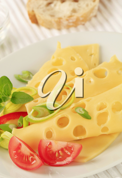 Slices of Swiss cheese sprinkled with spring onion