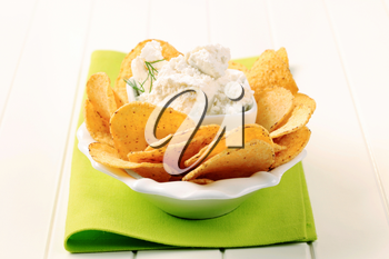 Bowl of tortilla chips and curd cheese