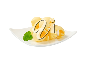 Curls of fresh butter on a plate