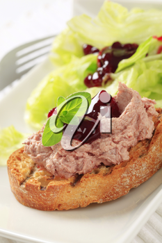 Toasted bread and pate with cranberry sauce and lettuce