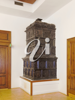 Ornate antique  stove in the corner of a room