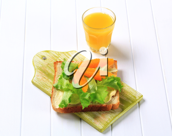 Healthy sandwich and glass of orange juice