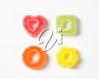 Fruit-flavored gelatin candy coated with sugar