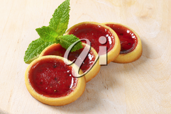 Mini tarts with red jam filling