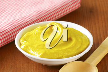 Bowl of American yellow mustard