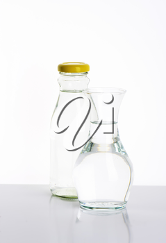 glass bottle and carafe of fresh water