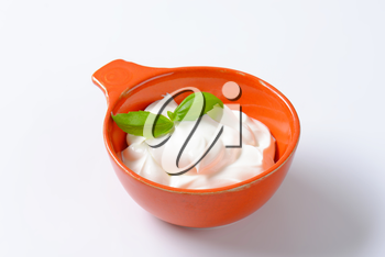 creme fraiche in an orange bowl
