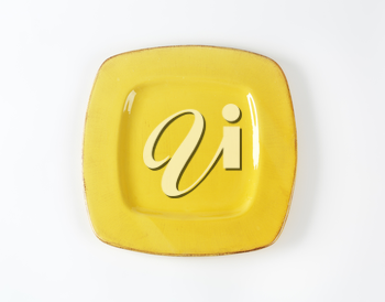 Yellow square plate with wide rim