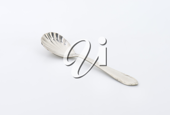 Cheese spoon with finely decorated cup and handle