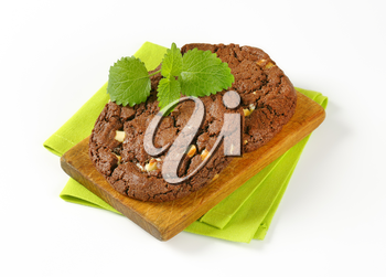 Chocolate nut fudge cookies, also called chocolate rads, on cutting board