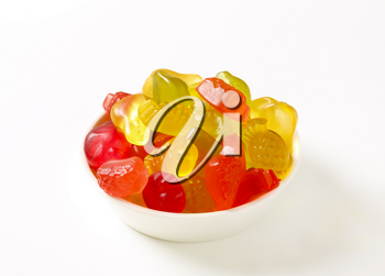 Fruit-shaped gummy candy in white bowl