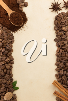 coffee beans and parchment as background