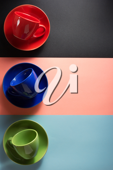 empty coffee cup and  saucer at abstract colorful background